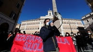 Student take part in a protest to demand more investments in schools, amid the spread of the COVID-19 outside Montecitorio Palace in Rome, Italy, Jan. 18, 2021.