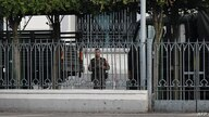 A soldier looks out from the City Hall compound in Yangon on February 1, 2021, as Myanmar's military detained the country's de…