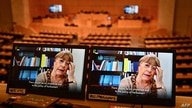 A picture taken on February 25, 2021 shows United Nations High Commissioner for Human Rights Michelle Bachelet on a screen as…