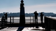 People enjoy a sunny winter Sunday in the Western Harbour of Malmo, Sweden February 14, 2021.