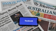 "An illustration image shows a phone screen with the ""Facebook"" logo and Australian newspapers in Canberra, Australia, February…"