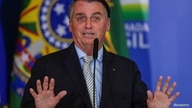 Brazil's President Jair Bolsonaro gestures during a ceremony at the Planalto Palace in Brasilia, Brazil February 24, 2021…