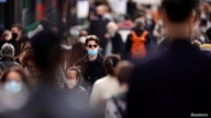 People, wearing protective masks, walk in the Montorgueil street in Paris amid the coronavirus disease (COVID-19) outbreak in…