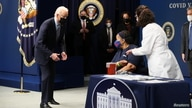 U.S. President Joe Biden watches as Linda Bussey, from Washington, DC, receives the first round of the Pfizer coronavirus…