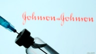 FILE - A vial and sryinge are seen in front of a displayed Johnson&Johnson logo in this illustration taken Jan. 11, 2021.