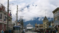 FILE - This July 29, 2014, file photo, shows a cruise ship docked in Skagway, Alaska, as passengers tour the town. The Alaska…