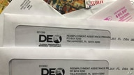 FILE - Envelopes from the Florida Department of Economic Opportunity Reemployment Assistance Program are shown.