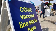 A sign is shown at a COVID-19 vaccine site in the Bayview neighborhood of San Francisco, Monday, Feb. 8, 2021. Counties in…