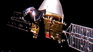 FILE - The Tianwen-1 probe en route to Mars. China said on Feb. 24, 2021, that its Tianwen-1 spacecraft has entered a temporary parking orbit around Mars in anticipation of landing a rover on the red planet in the coming months.