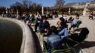 People sunbathe at the Tuileries garden in Paris, as temperatures hit 19 degrees Celsius (62 Fahrenheit) Wednesday, Feb. 24,…