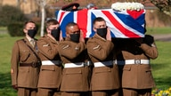 The coffin of Captain Tom Moore is carried by members of the Armed Forces during his funeral, at Bedford Crematorium, in…