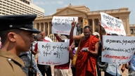 """FILE - Protesters in Sri Lanka denounce the government's decision to issue death certificates for persons gone missing during country's civil war, in Colombo, Feb. 11, 2020. The placards read """"Who killed the disappeared?"""" in Tamil and Sinhalese."""