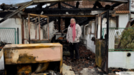 Serbia, Belgrade, Milan Jovanovic in front of his burnt home, december 2018