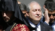 FILE - Armenian President Armen Sarkissian attends a wreath-laying ceremony in Yerevan, Armenia April 24, 2018.