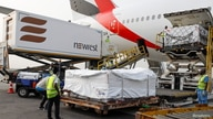 Workers offload boxes of AstraZeneca/Oxford vaccines as the country receives its first batch of coronavirus disease (COVID-19) vaccines under COVAX scheme, at the international airtport of Accra, Ghana, Feb. 24, 2021.
