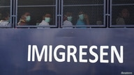 Myanmar migrants to be deported from Malaysia are seen inside an immigration truck, in Lumut, Malaysia, Feb. 23, 2021.