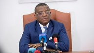 Cameroon's Prime Minister Joseph Dion Ngute listens during an interview with AFP in Yaounde on October 3, 2019. - President…