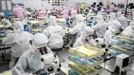This photo taken on June 16, 2020 shows workers producing LED chips at a factory in Huaian, in China's eastern Jiangsu province…
