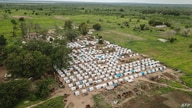 An aerial view taken on February 24, 2021 shows temporary houses in the Napala Agrarian Center of Metuge District, Cabo Delgado…