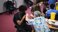 Members of the public receive a dose of the AstraZeneca/Oxford vaccine at a coronavirus vaccination centre at the Fazl Mosque…