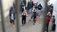 Prisoners from Iraq and Syria, suspected of being part of the Islamic State, spend time in a prison's outside grounds in Hasaka…