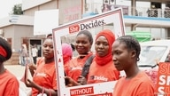 """Young activists at the """"She Decides"""" march against sexual violence in Lilongwe, Malawi, on March 2, 2020."""