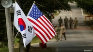 FILE - The South Korean and American flags fly next to each other at Yongin, South Korea.