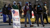 A sign is seen as voters line up for the U.S. Senate run-off election, at a polling location in Marietta, Georgia.