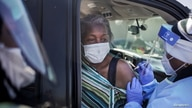 Mary Bailey, of New Orleans, receives a Moderna coronavirus disease (COVID-19) vaccination from Doctor Areaine Johnson.