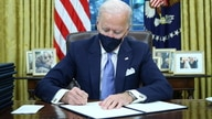 U.S. President Joe Biden signs executive orders in the Oval Office of the White House in Washington, after his inauguration as…