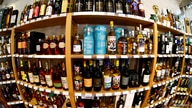 FILE PHOTO: Bottles of single malt scotch whisky are pictured in a shop near Lausanne, Switzerland May 18, 2017. Picture taken…