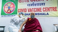 Tibetan spiritual leader, the Dalai Lama, receives a dose of coronavirus disease (COVID-19) vaccine at a vaccination centre in…