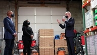 "U.S. President Joe Biden speaks with owners James Smith and Kristin Smith during a ""Help is Here Tour"" event."