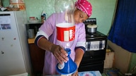 A woman in South Africa using Folia Water in 2016.