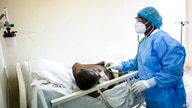 FILE - In this Wednesday, May 13, 2020 file photo, a doctor uses a stethoscope to listen to the breathing of a patient…