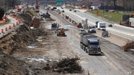 FILE - In this April 20, 2020, file photo work continues on the Interstate Highway 75 project in Hazel Park, Mich. Looking…