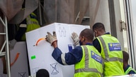AstraZeneca COVID-19 vaccines are received by airport workers at the airport in Kigali, Rwanda Wednesday, March 3, 2021. More…