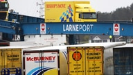 FILE - In this file photo dated Tuesday, Feb. 2, 2021, vehicles disembark from a ferry arriving from Scotland at the port of…