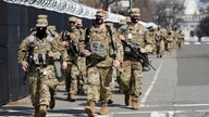 National Guard walk near the Capitol, Thursday, March 4, 2021, on Capitol Hill in Washington.