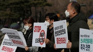 South Korean protesters hold signs during a rally to oppose the joint military exercises between South Korea and the United…
