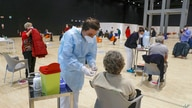 Medical staff members administer the AstraZeneca vaccine at La Nuvola (The Cloud) convention center that was temporarily turned…
