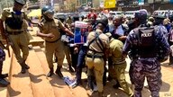 National Unity platform party President Robert Kyagulanyi, better known as Bobi Wine, was being arrested at the Constitutional square after a street protest against abductions and torture, March 15, 2021. (Halima Athumani/VOA)