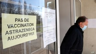 """A man leaves a vaccination site with a sign reading """"No vaccination with the AstraZeneca vaccine today,"""" in Saint-Jean-de-Luz, southwestern France, March 16, 2021."""
