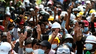 Anti-coup protesters flash the three-finger sign of resistance during a demonstration in Mandalay, Myanmar, March 6, 2021.