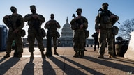 National Guard troops and members of the U.S. Capitol Police keep watch as security remains high on Capitol grounds following the Jan. 6 attack by supporters of then-President Donald Trump, in Washington, March 3, 2021.