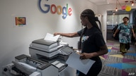 A woman makes copies at the Google Artificial Intelligence (AI) office in Accra on April 10, 2019. - This centre is the first…