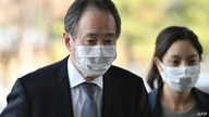 Japanese ambassador to South Korea Koji Tomita (L) arrives at the foreign ministry in Seoul on March 6, 2020 as Seoul summons…