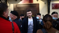 A man wearing a T-shirt with an image of Russian President Vladimir Putin leaves the Basmanny district court during a hearing…