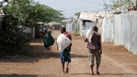 Men carry bags of food aid at the Kakuma refugee camp in northern Kenya, March 6, 2018. Picture taken March 6, 2018. REUTERS…