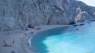 FILE - People visit Porto Katsiki beach, following the easing of measures against the spread of the coronavirus disease.